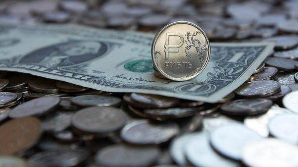 Судьбу рубля решают баррель и рейтинг