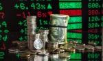 Курс доллара по итогам основной биржевой сессии повысился на 18 копеек, евро понизился на 5